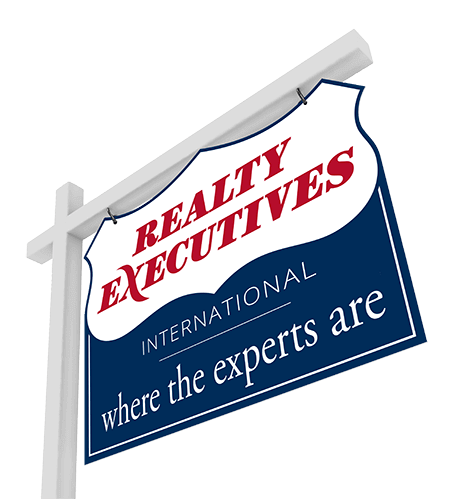 a real estate property sign displaying the Realty Executives logo and slogan where the experts are