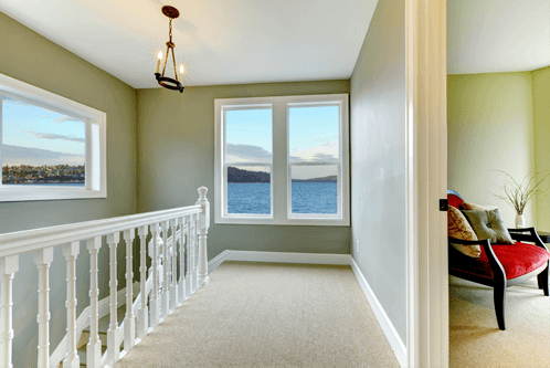 interior of a freshly-painted upstairs hallway with a beautiful ocean view