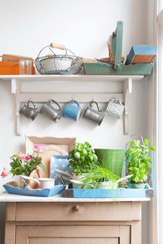 potted flowers and herbs add lively color to a garden workbench with country charm