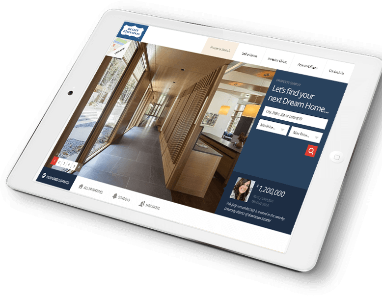 the Realty Executives International website displaying on a tablet resting on a hardwood floor