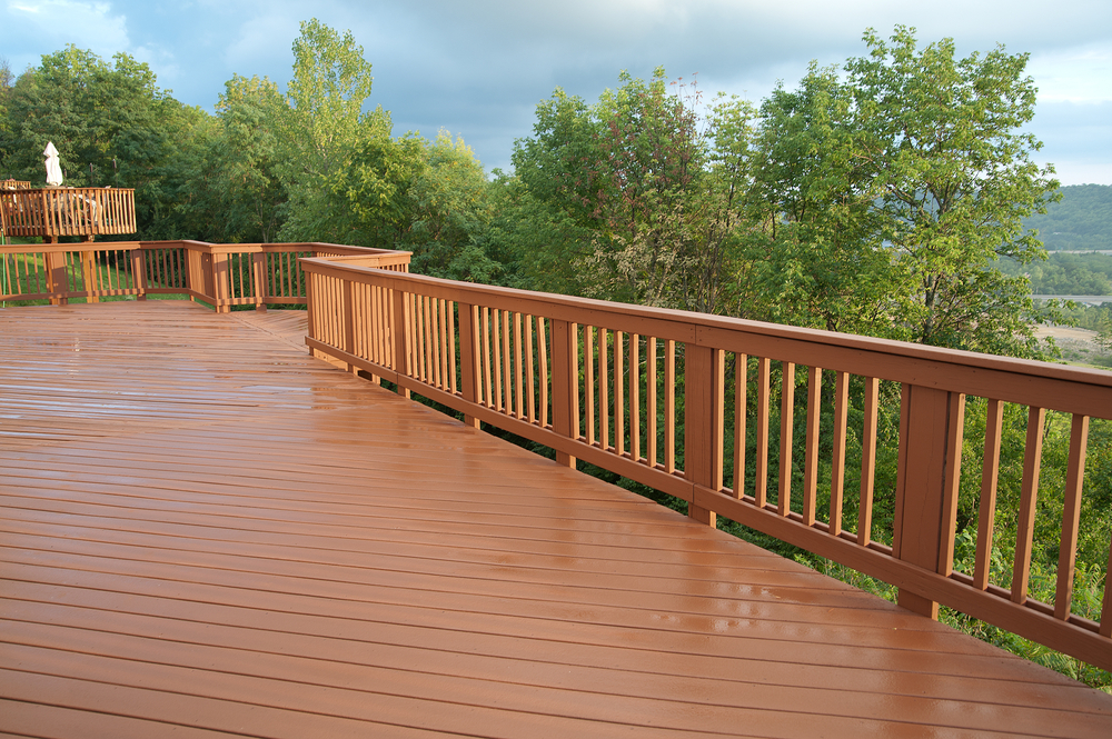 When inspecting deck railings, confirm that the posts and balusters are in sound condition and firmly attached. (Picture courtesy of Shutterstock)