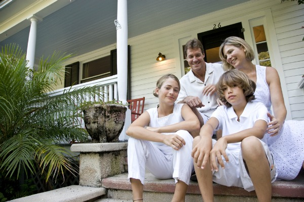 family-sitting-on-front-steps