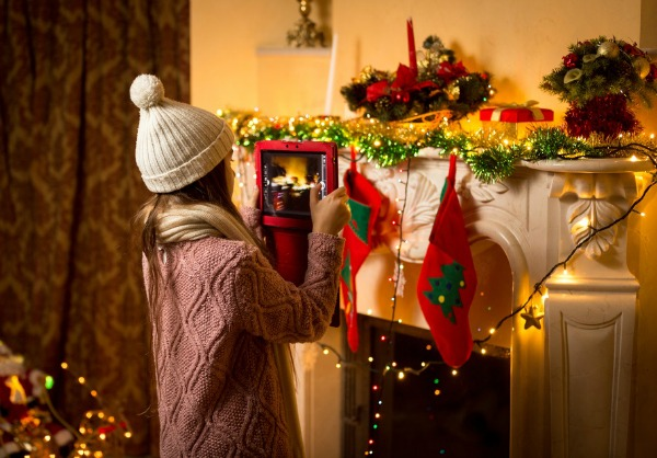 Girl taking photo of Christmas decorations