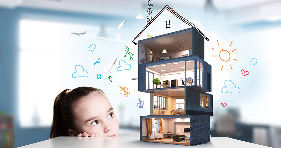 Cute girl looking at model of house