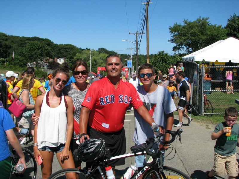Broker/Owner Ari Koufos poses with his daughter Emily, wife Debra, and son Chris (l to r) after completing the 36th Pan Mass Challenge