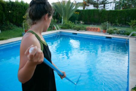 woman cleaning the pool
