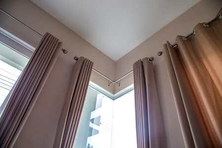 mauve colored blackout curtains covering windows so you can get better sleep.