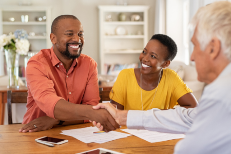 Two people working with their insurance broker to answer questions and select the right homeowners insurance plan.
