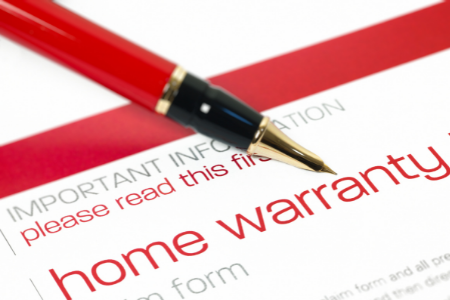 A red pen ready to sign a home warranty plan.