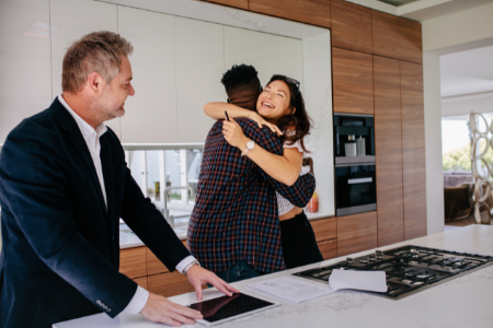 two clients embracing after working with an Executive to buy a home.