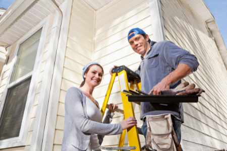 A couple keeps up on home repairs, a strategy we recommend to boost your bank account.