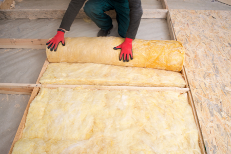 A man checking the insulation in a home.