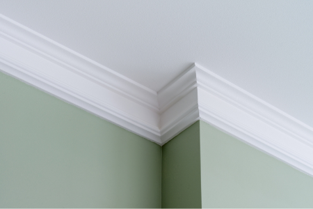 crown molding over a green wall