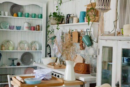 a decorative and cluttered granny chic kitchen space