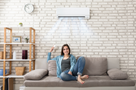 Woman enjoying the AC in her living room.