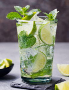 A mojito with limes and mint.