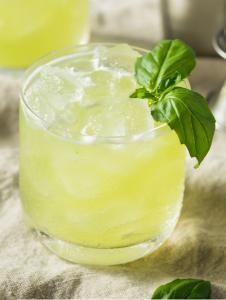 A gin basil smash in a glass.