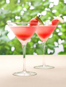 Two watermelon martinis on a table, a perfect summer cocktail.