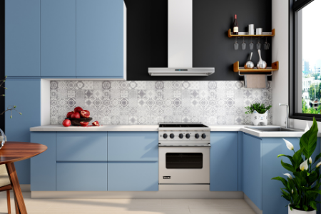 A kitchen with a new stove next to blue cabinets.