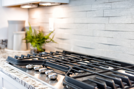 Metal grates on a gas stove are easy to clean.