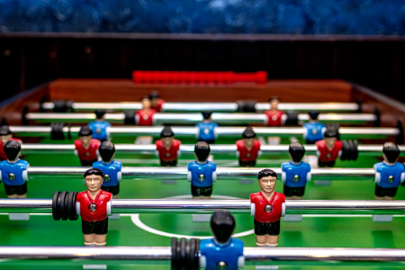 A foosball table with red and blue players.